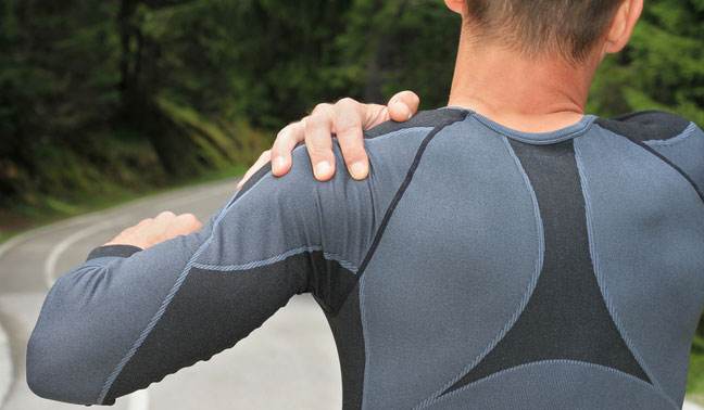 man holding a sore shoulder