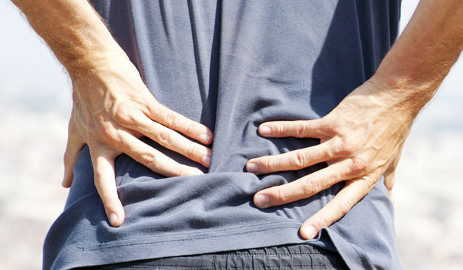 sciatic man hands on lower back pain