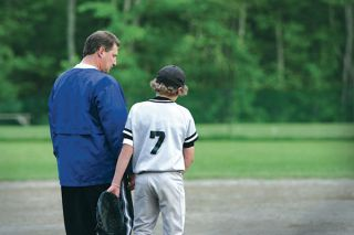baseball coach with his player