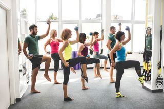 Exercise class with weights and legs up