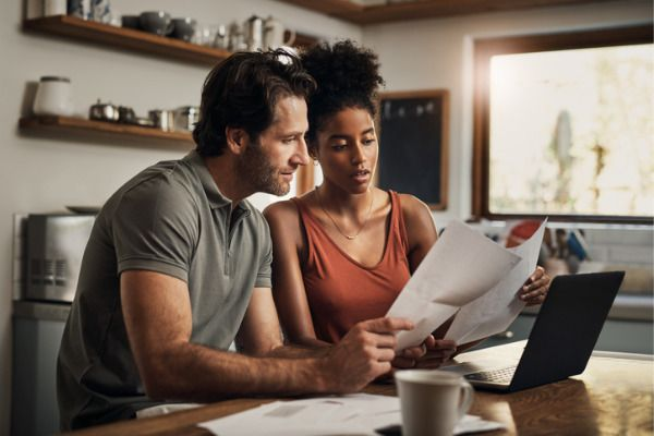 a couple reviewing their financial statements in their kitchen
