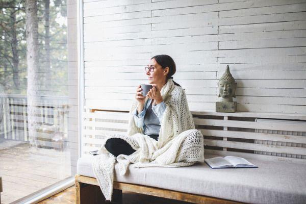 woman relaxing drinking tea