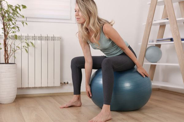 a woman doing pelvic floor exercises at home