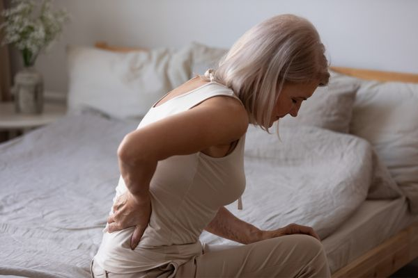 an older woman experiencing back pain