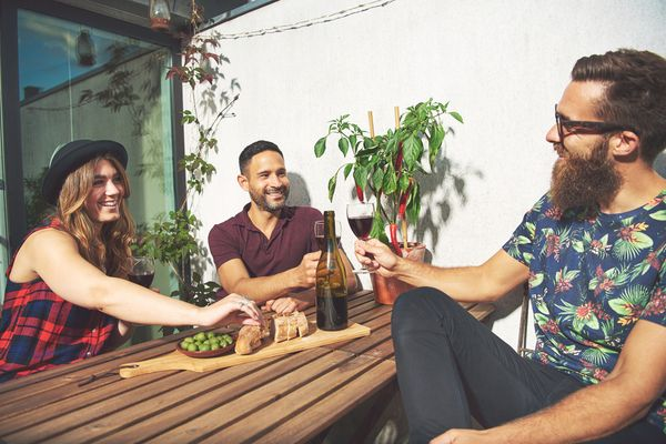 a group of friend's enjoying a drink outdoors