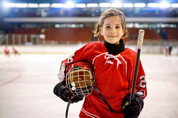 young girl in a hockey rink