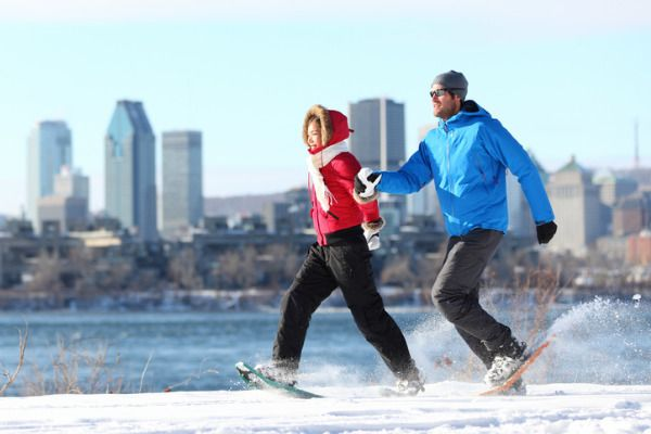couple snowshoeing in the city