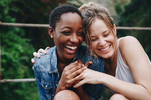 an image of two young women laughing