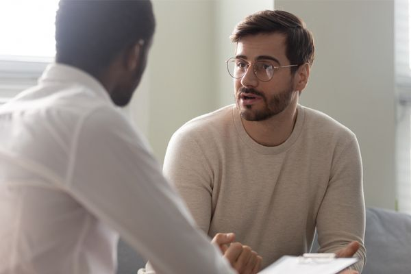 Man consulting with a mental health practitioner