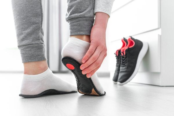 a photo of an orthotic being fitted on a foot