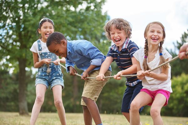 A group of children playing in a park