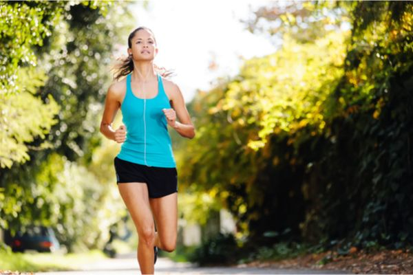 a woman running outside with earphones