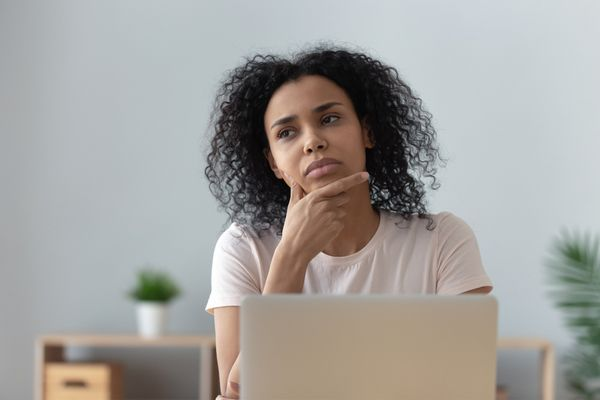 a woman thinking pensively at home