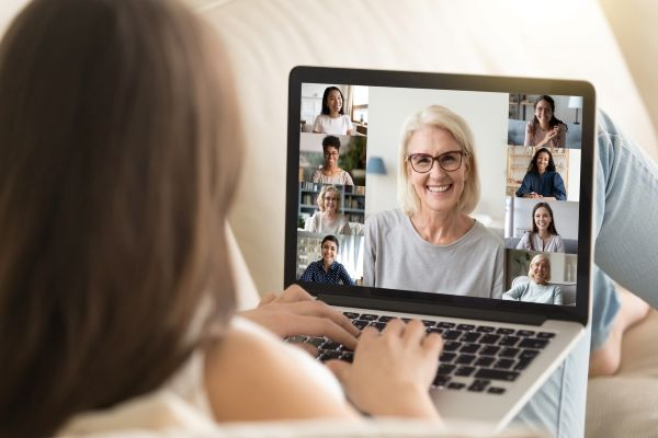 woman socializing with family and friends on zoom