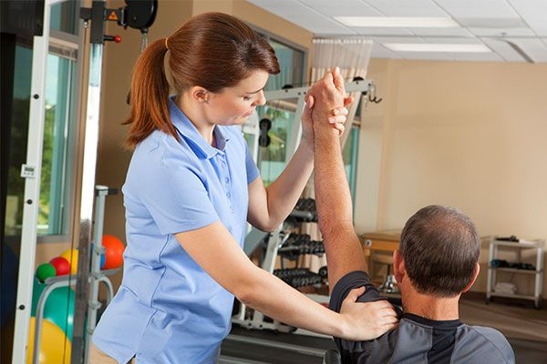 man getting rehab and physiotherapy