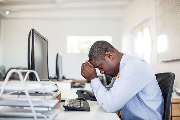 Man with concussion at desk