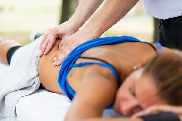 woman receiving a massage on her back