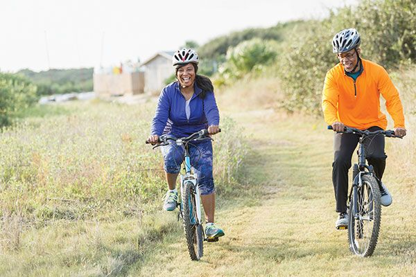 couple happily cycling
