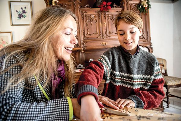 Mother and son wrapping presents together