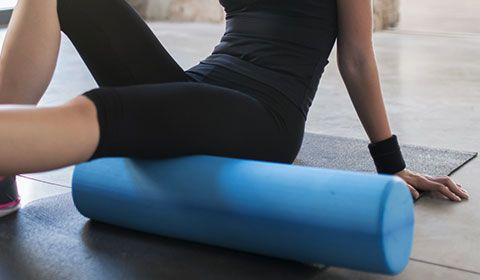 using a foam roller to release myofascial tension on self