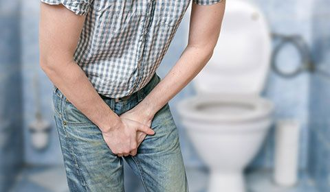 man holding crotch has to urinate