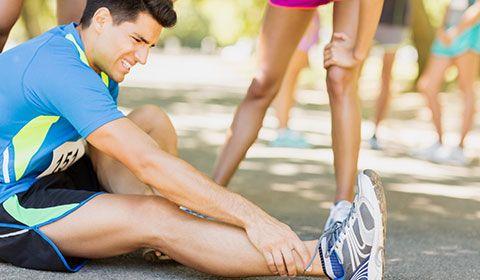 injured marathon runner sprained ankle