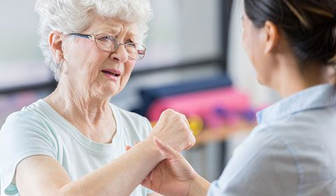 Patient and Physiotherapist working on muscle movement
