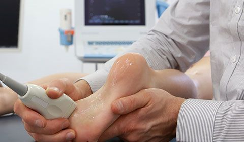 Podiatrist doing an ultrasound on a foot