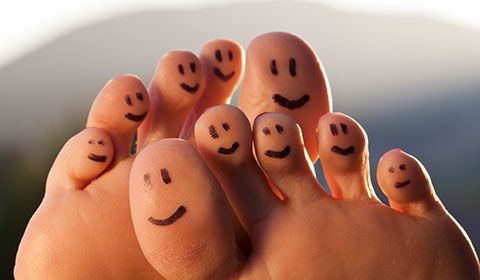 toes with happy faces drawn on them