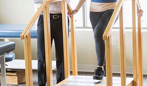 patient walking up steps during physio assessment