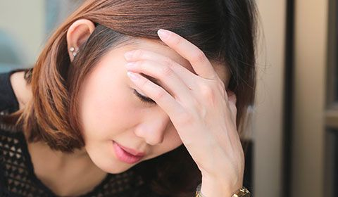 Woman with symptoms of pain and dizziness