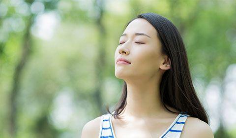 woman breathing easily