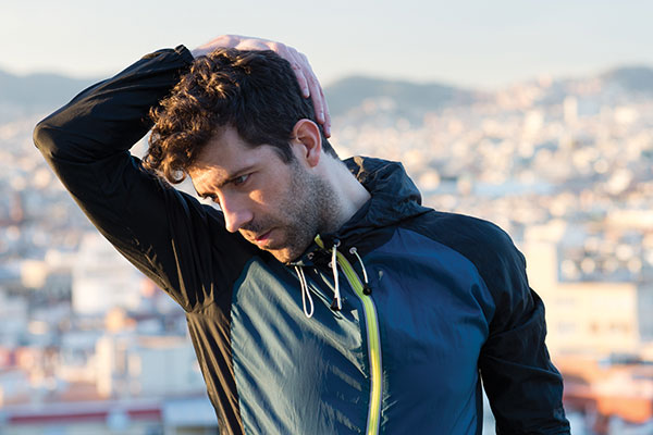 man stretching neck before running