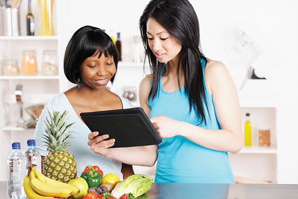 nutritionist working with client on Ipad