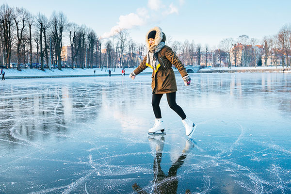 woman skating on outdoor pond